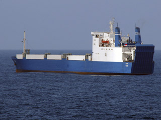 The pirated merchant ship MV Faina is seen from a U.S. Navy guided-missile cruiser